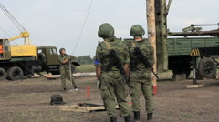 Russian Soldiers work with Pile Driver. Stock Footage