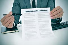 Young man showing a confidentiality agreement document Stock Photos