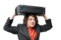 Businessman holding luggage above head to protect from rain and other weather Stock Photos
