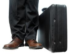 a standard, default black briefcase with handle at top isolated on a pure whi - stock photo