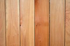 wooden fence background. it looks like the wood is clean and new. - stock photo
