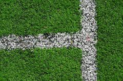 an abstract closeup of an american football field lines on artifical green tu - stock photo