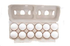 dozen of eggs in egg cartion isolated on white - stock photo