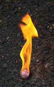 fireball burning on a black asphalt cement - stock photo