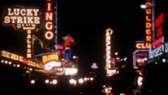 1380 - Las Vegas signs at night - vintage film home movie Stock Footage