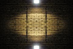 Stock Photo of old rough brick wall background texture with a spotlight shining on it