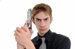 Undercover cop aims with his handgun pistol on white background. Kuvituskuvat