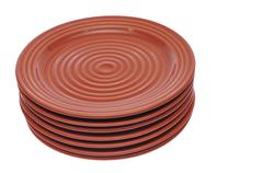 Seven red/brown plates stacked on each other Stock Photos