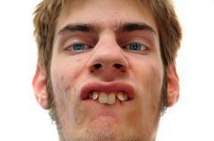 Weird white caucasian facial expression isolated on white background Stock Photos