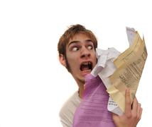 Man being attacked by an overload of paperwork! Stock Photos