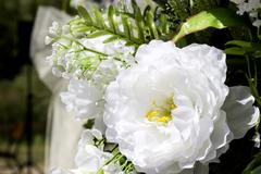 close-up wedding place decoration with artificial flowers - stock photo