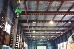 Hoist with bridge crane and scales in warehouse Stock Photos