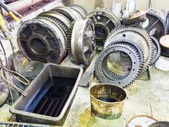 gears of disassembled engine in workshop - stock photo
