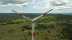 Zoom out in front of Wind turbine blades nose Stock Footage