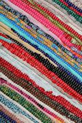 recycling, handmade colorful ethnic retro rug - stock photo
