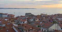 Stock Video Footage of Sunset time at Piran in southwestern Slovenia on the Gulf of Piran, 4K