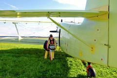 Biplane and parachutes Stock Photos
