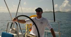 Captain sailing on the Caribbean sea Stock Footage
