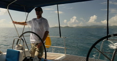 Sailboat Captain at sea in the caribbean Stock Footage