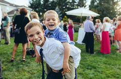 brothers piggyback - stock photo
