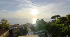 Fornace Portoroz Piran Slovenia Adriatic sea Istria coast backlit sunset sun Stock Footage