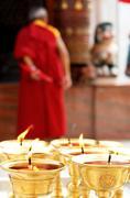 Praying candles in bodhnath stupa Stock Photos