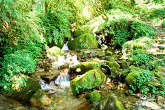 Stock Photo of Water stream movement on the stone background