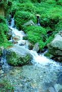 Water stream movement on the stone background - stock photo