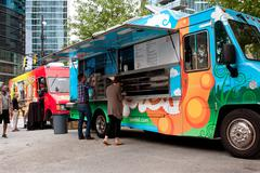 customers order meals from colorful atlanta food truck - stock photo