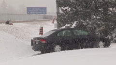 Car in ditch in severe snow storm and blizzard Stock Footage