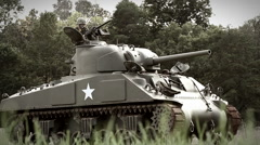 Sherman tank with Machine Gunner rolling through field 2 Stock Footage