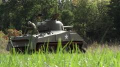 Sherman tank w/ top gunner in field | World War II (Standard Color) Stock Footage