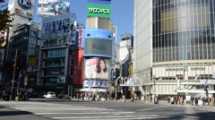 Timelapse video of crowds of people and traffic in Tokyo, Japan Stock Footage