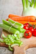 fresh organic fennel, celery, carrot and tomatoes - stock photo