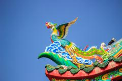Bird statue in the coner roof Stock Photos