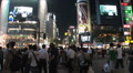 Shibuya, Tokyo, Japan. The famous crossing. People waiting. Neon signs. Traffic HD Footage