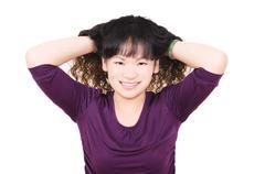 Beautiful girl perm her hair Stock Photos