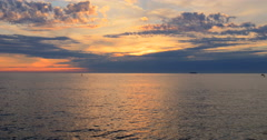 Sea ocean water sunset afterglow afterlight after glow light rays beams clouds Stock Footage