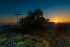Summit cross at sunset Stock Photos
