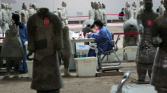 Archaeological workers repairing Terra Cotta warriors in Qinshihuang mausoleum Stock Footage