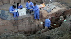 Archaeological workers repairing Terra Cotta warriors in Qinshihuang mausoleum - stock footage