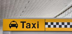 NEW YORK CITY - CIRCA JUNE 2013: Taxi station signage and classi Stock Photos