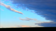 Time lapse of clouds moving in windy sunrise - tilt shift effect. Stock Footage