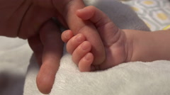 Newborn Baby Squeezing Dad's Hand - stock footage