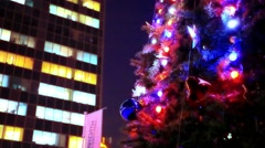 Evening winter christmas tree and business center in the street. Change focus on Stock Footage