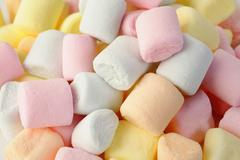 Small colored puffy marshmallows Stock Photos