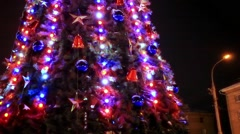 Christmas tree and decorations on night background in the street. Shift motion. - stock footage