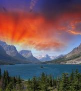 Goose Island Sunset - Clearing storm clouds reveal the mountain - stock photo