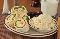 Turkey sandwich with macaroni salad - stock photo