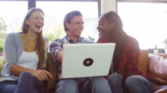 4K Portrait of cheerful young friends hanging out together with laptop computer - stock footage